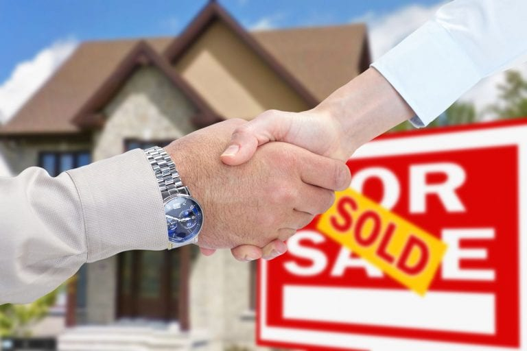how to invest 50k in real estate through a partnership