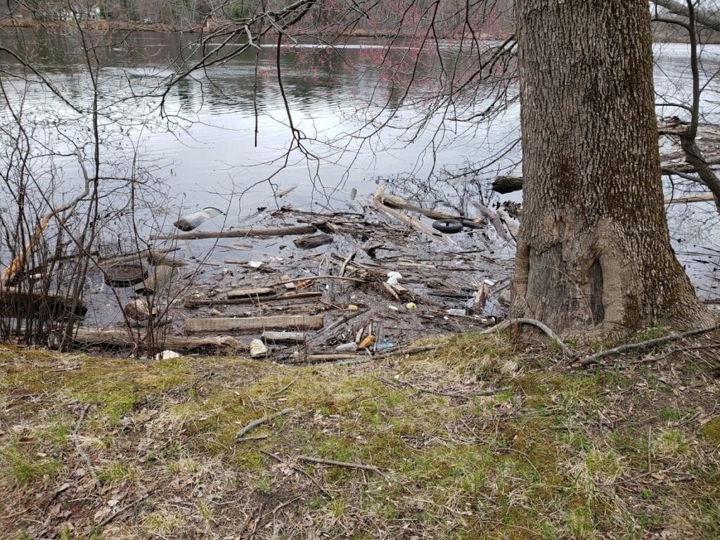 Buying a Rental Property - Trash Along the Nearby River